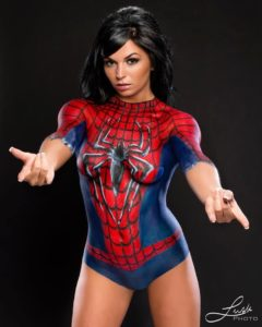 model in spiderman body paint